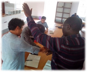 Rev. Isale Amos Dedicates Dr. Hong and Mr. Jacob Kim into the hand of God as they begin execute their new duties